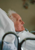 Picture of an elderly, bed-ridden man