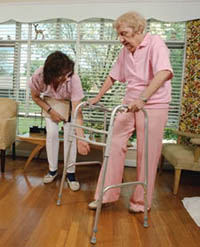 Picture of an elderly woman using a walker during a physical therapy session
