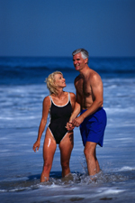 Picture of older couple playing on the beach
