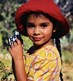 Picture of a young girl with a camera, smiling