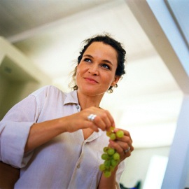 Photo of woman eating grapes