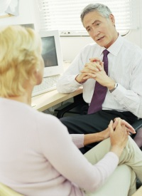 Doctor speaking to a woman in an office