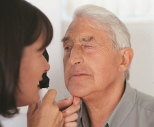 Older man getting check-up from doctor