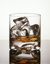 A glass holding liquor and ice