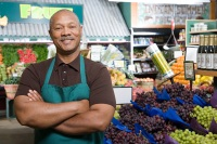 Healthy-looking African-American man standing in the produce section of a market
