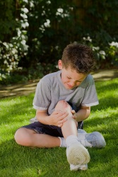 Boy with cut on his knee
